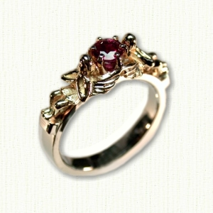 14Kt white gold 'Angel'engagement ring set with a 5mm round garnet.