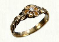 14ky antique replica flower ring with .03ct bezel set diamond