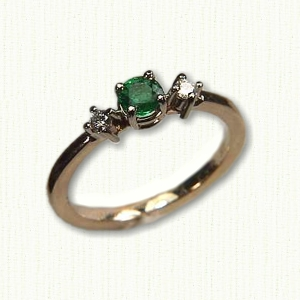 14Kt yellow gold 'April' set with a .33ct round emerald and two .05ct round diamonds.