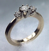14Kt yellow gold 'Barbara' set with a .40ct round diamond and two side .05ct round diamonds.