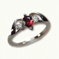 14Kt yellow gold 'Deborah' set with a pear shaped garnet and two side diamonds.