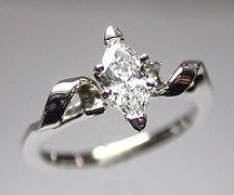 14Kt white gold 'Lisa' set with a .51ct marquise cut diamond.