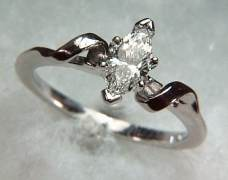 14kt white gold 'Lisa' set with a .49ct marquise cut diamond.